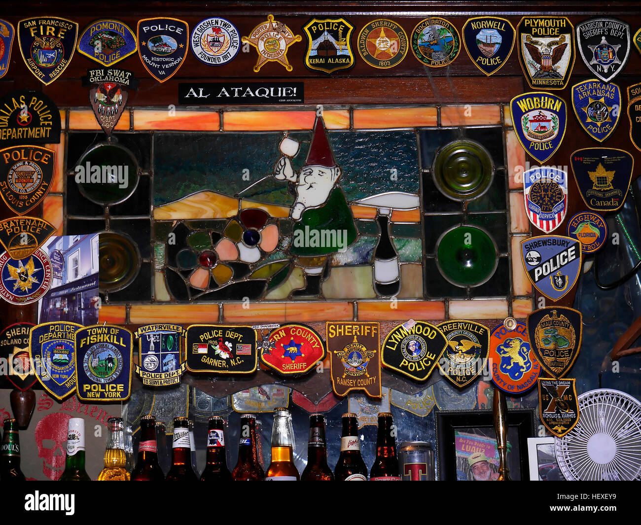 irish bar with display of embroidered police badges from all over