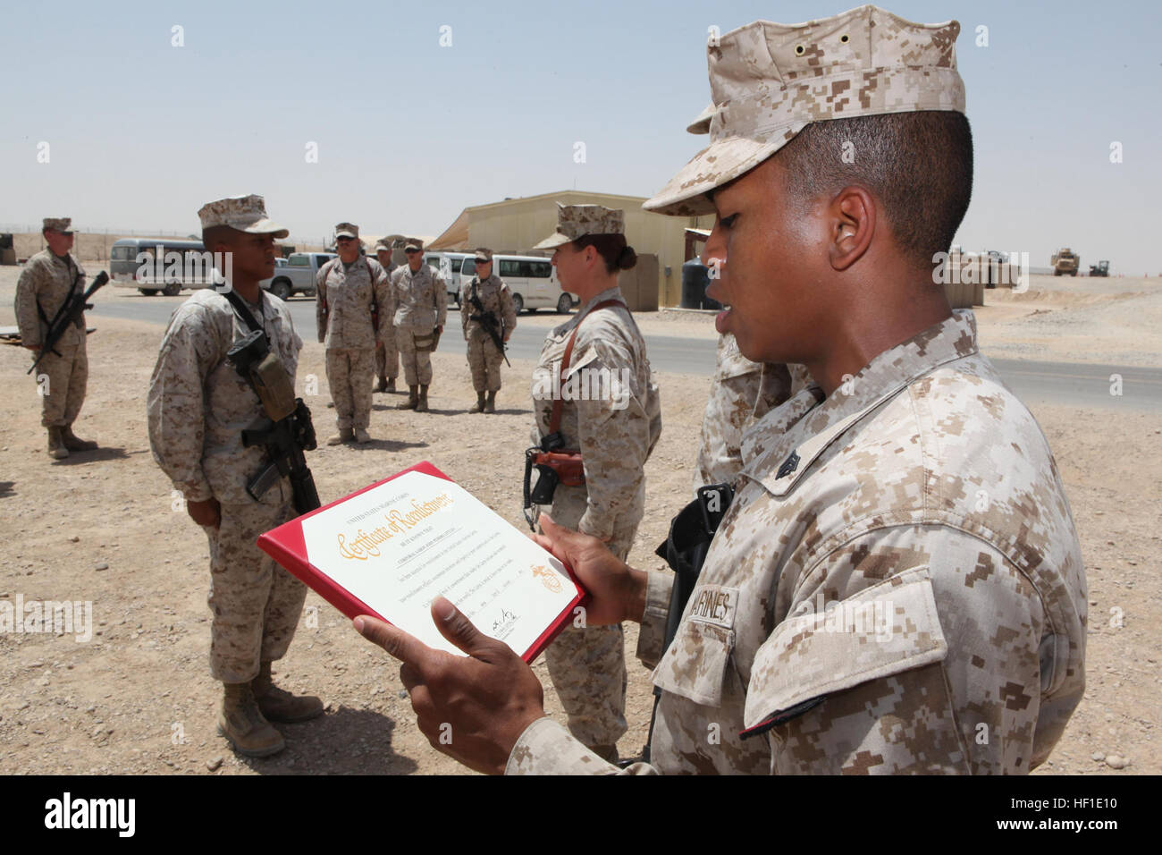 u s marine sgt ray c littles an administrative clerk nd stock photo u s marine sgt ray c littles an administrative clerk 2nd marine aircraft wing forward reads a promotion warrant during a
