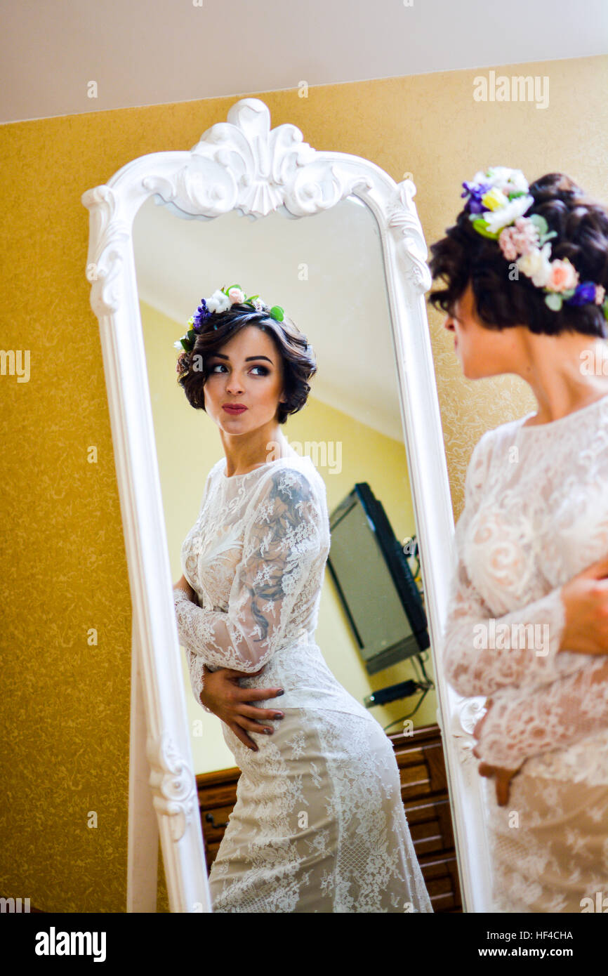 Beautiful Bride In White Lace Dress And Flowers In Hair Waiting In