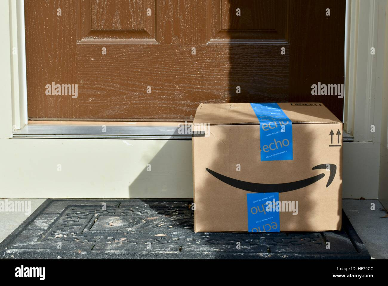 An Amazon Prime package delivered to the front door of a home & An Amazon Prime package delivered to the front door of a home ...