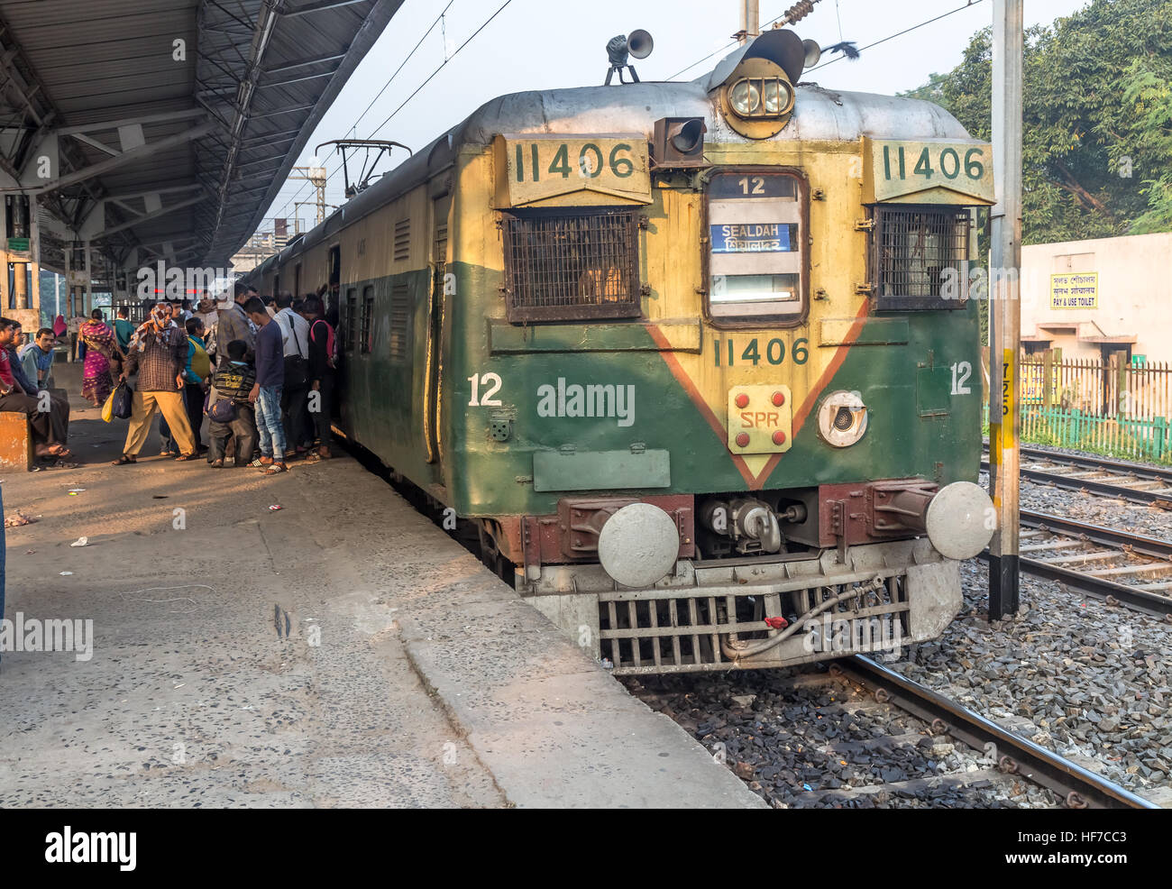 Local passenger train of Indian railways off loading ...