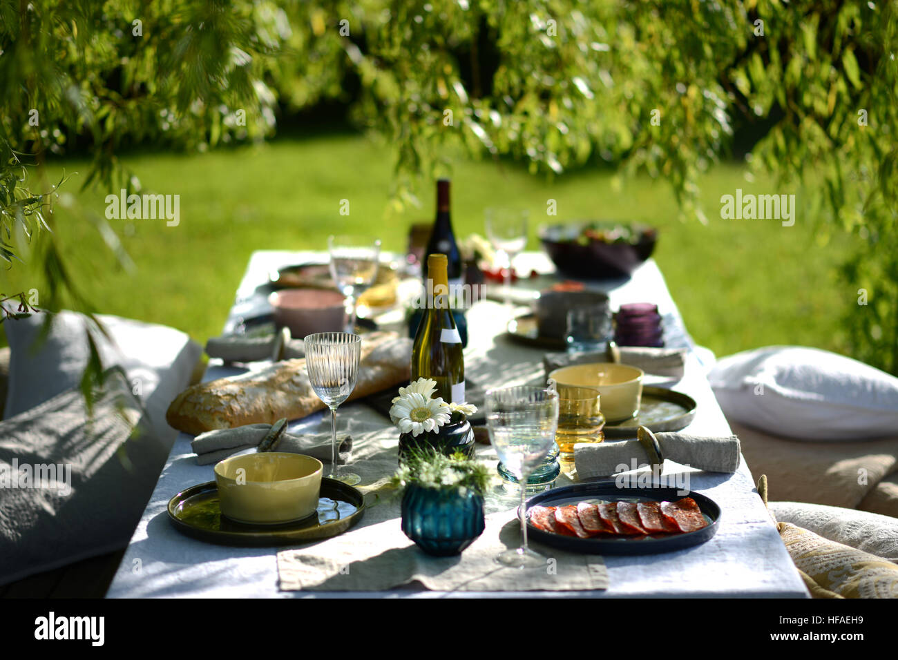 Alfresco dining table set for an evening meal outside Stock Photo