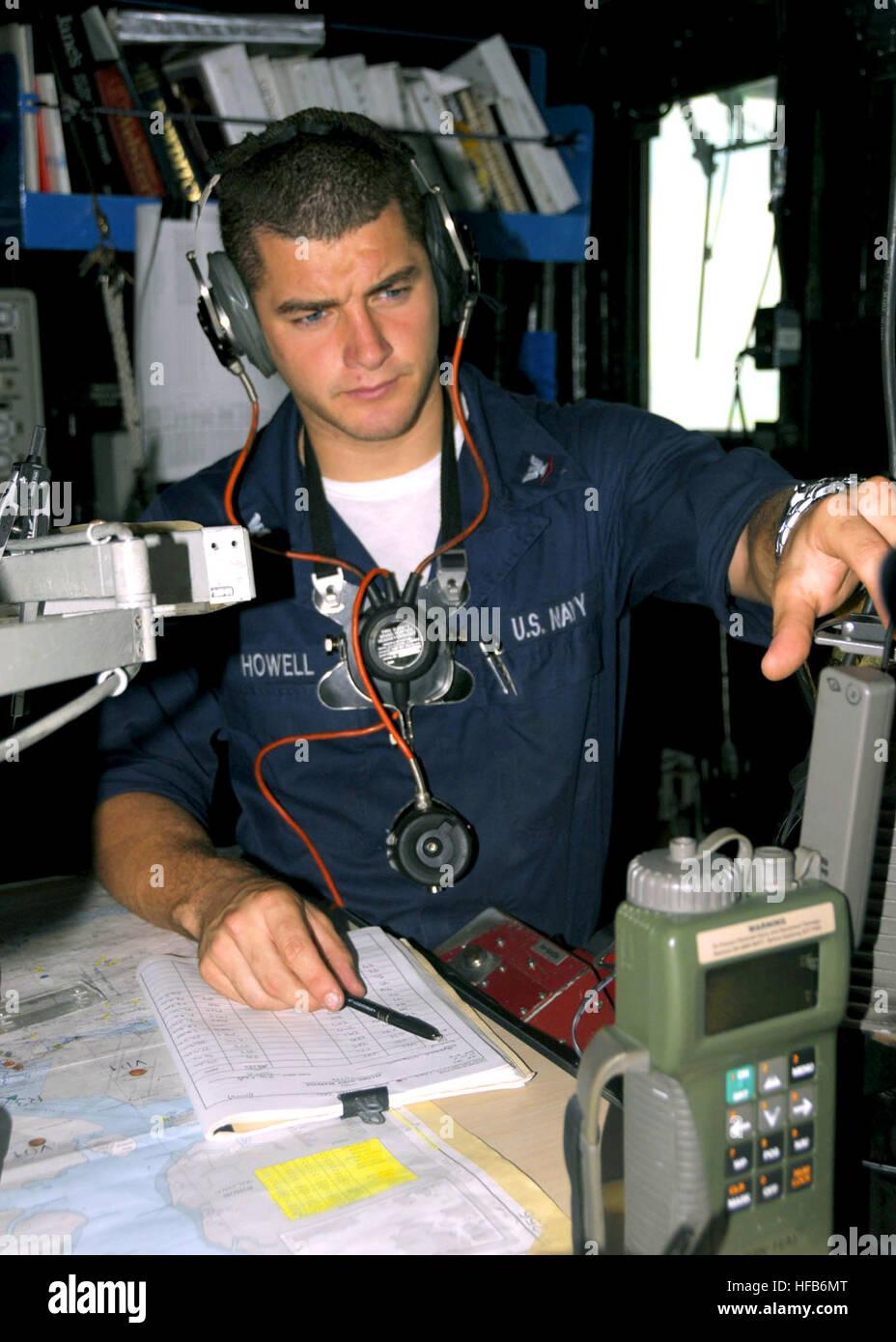 U.S. Navy Quartermaster 3rd Class Russell J. Howell checks the ...