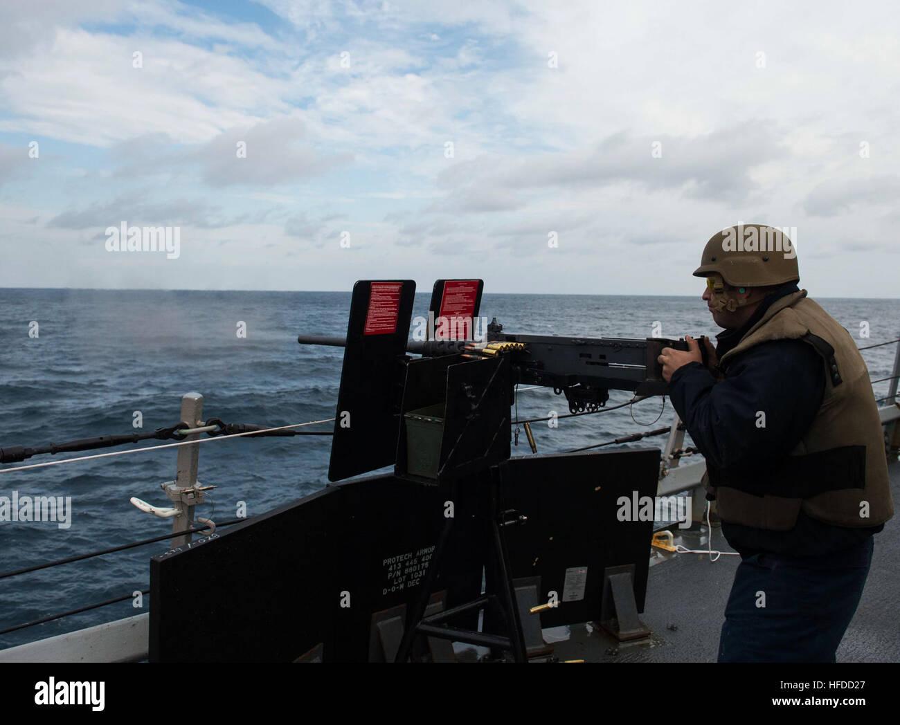 U.s. Navy Gunner's Mate 3rd Class Eric Adkins Fires A .50-caliber ...