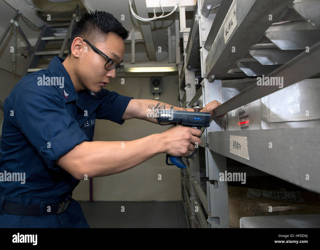 U.S. Navy Logistics Specialist 3rd Class Johnny Bae scans ...