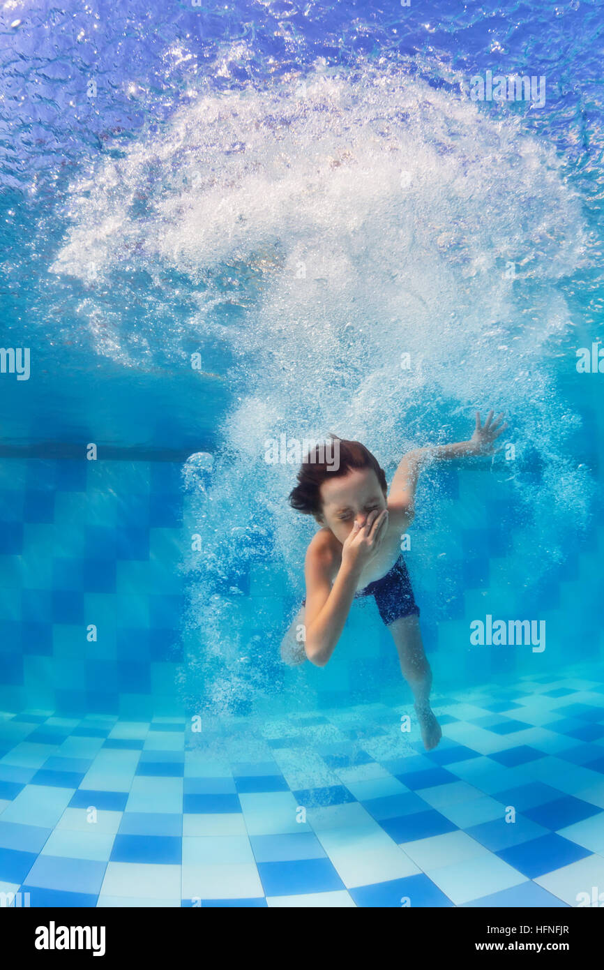 Funny Child Swimming And Diving In Pool With Fun Jumping Deep Down Stock Photo Royalty Free