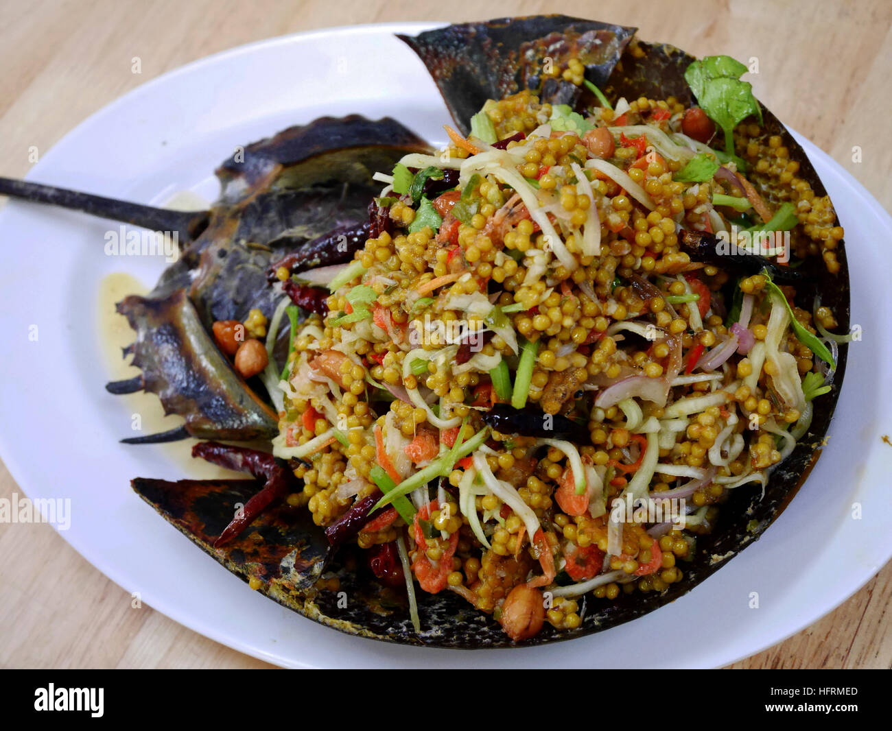 Thai cuisine spicy horseshoe crab egg salad in restaurant for 8 spices thai cuisine