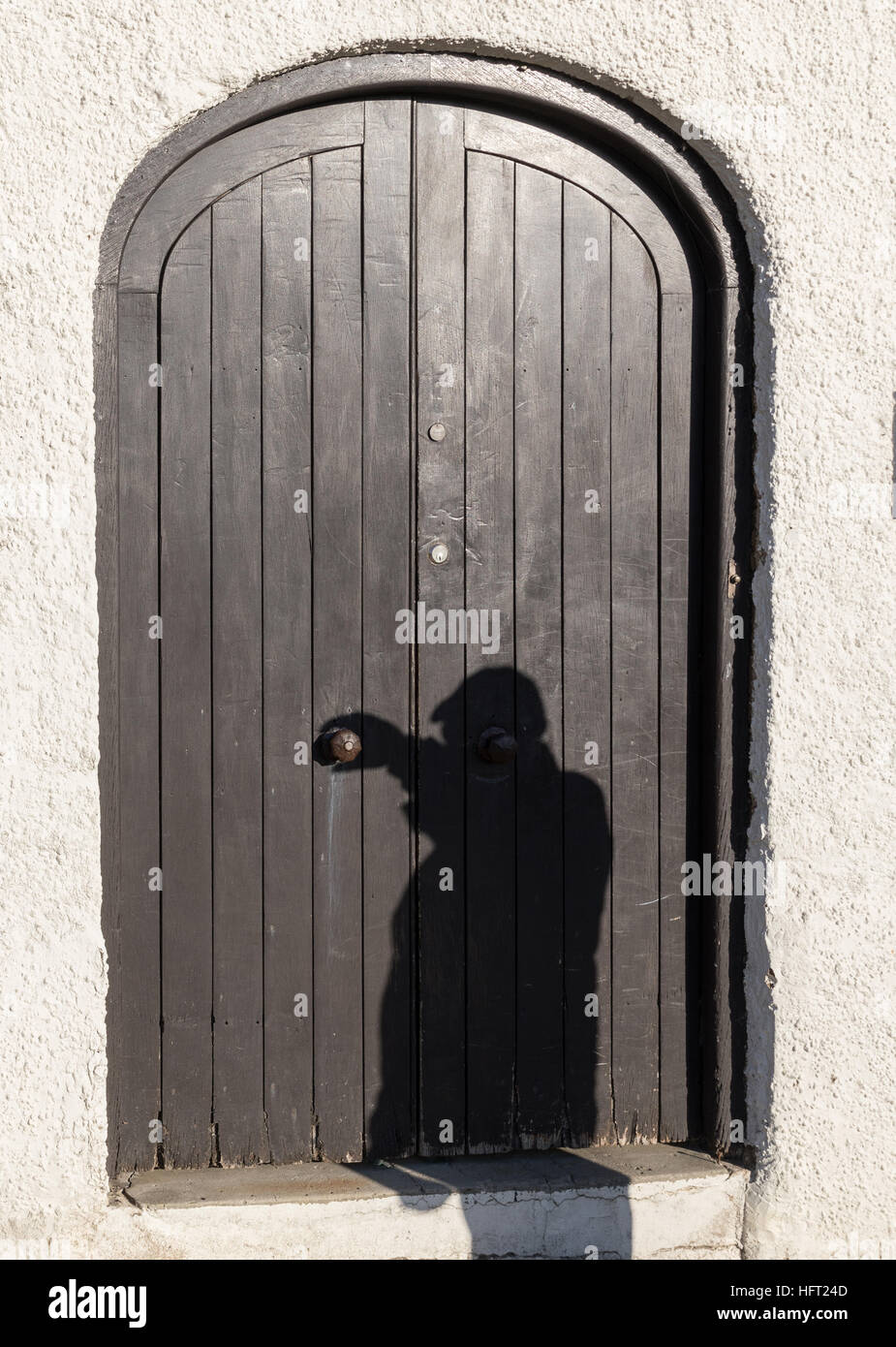 shadow illusion of man with hand up to turn handle and open door & shadow illusion of man with hand up to turn handle and open door ...