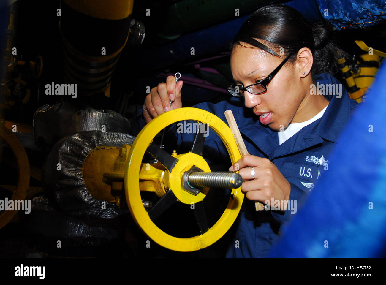 27 2009 machinist mate fireman candilyn elam does maintenance on a pressure valve in the forward diesel room aboard the aircraft carrier uss nimitz cvn