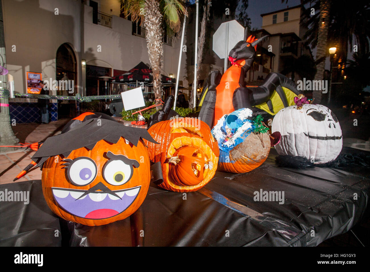 decorated pumpkins and an inflated dragon are on exhibit at a halloween decorating contest in huntington beach ca - Halloween Decorating Contest