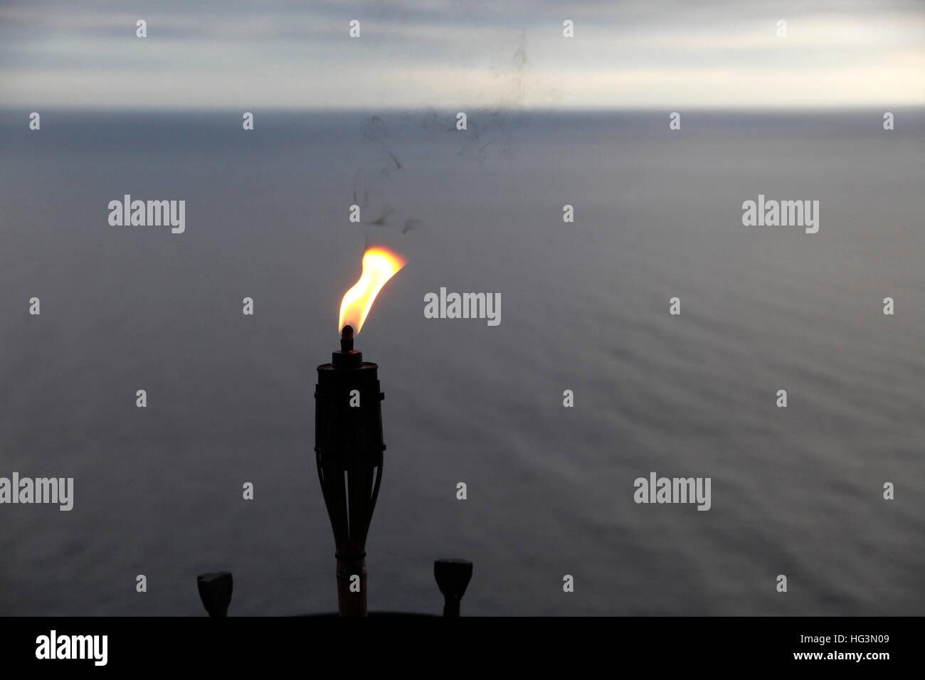 torch in front of the mediterranean sea at far de sant sebasti agrave  stock photo torch in front of the mediterranean sea at far de sant sebastiagrave lighthouse llafranc girona costa brava catalonia spain