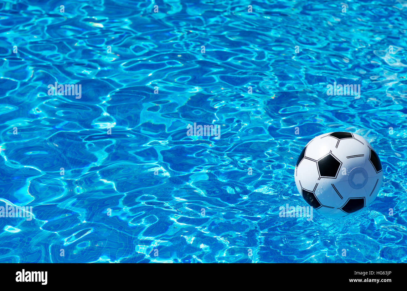 Beach Ball In Water beach ball floating in blue swimming pool. space for text stock