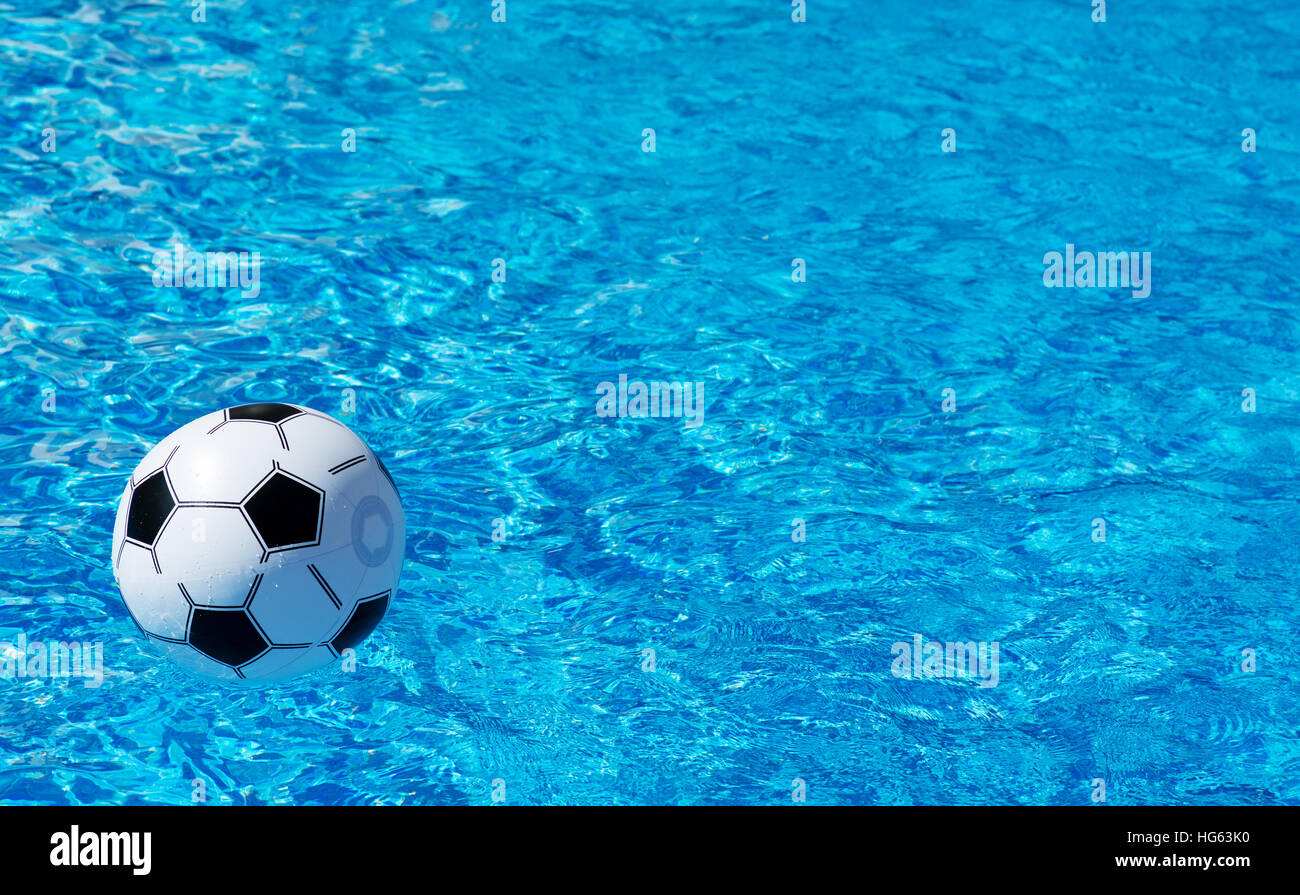 pool water with beach ball. Beach Ball Floating In Blue Swimming Pool. Space For Text Pool Water With M
