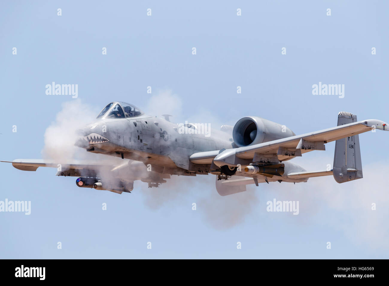 A U.S. Air Force A-10 Thunderbolt II fires its 30mm gun at ...
