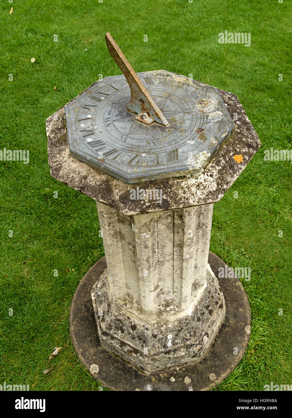 Sundial garden ornament - Old Pedestal Garden Sundial With Engraved Roman Numerals Uk Stock Image
