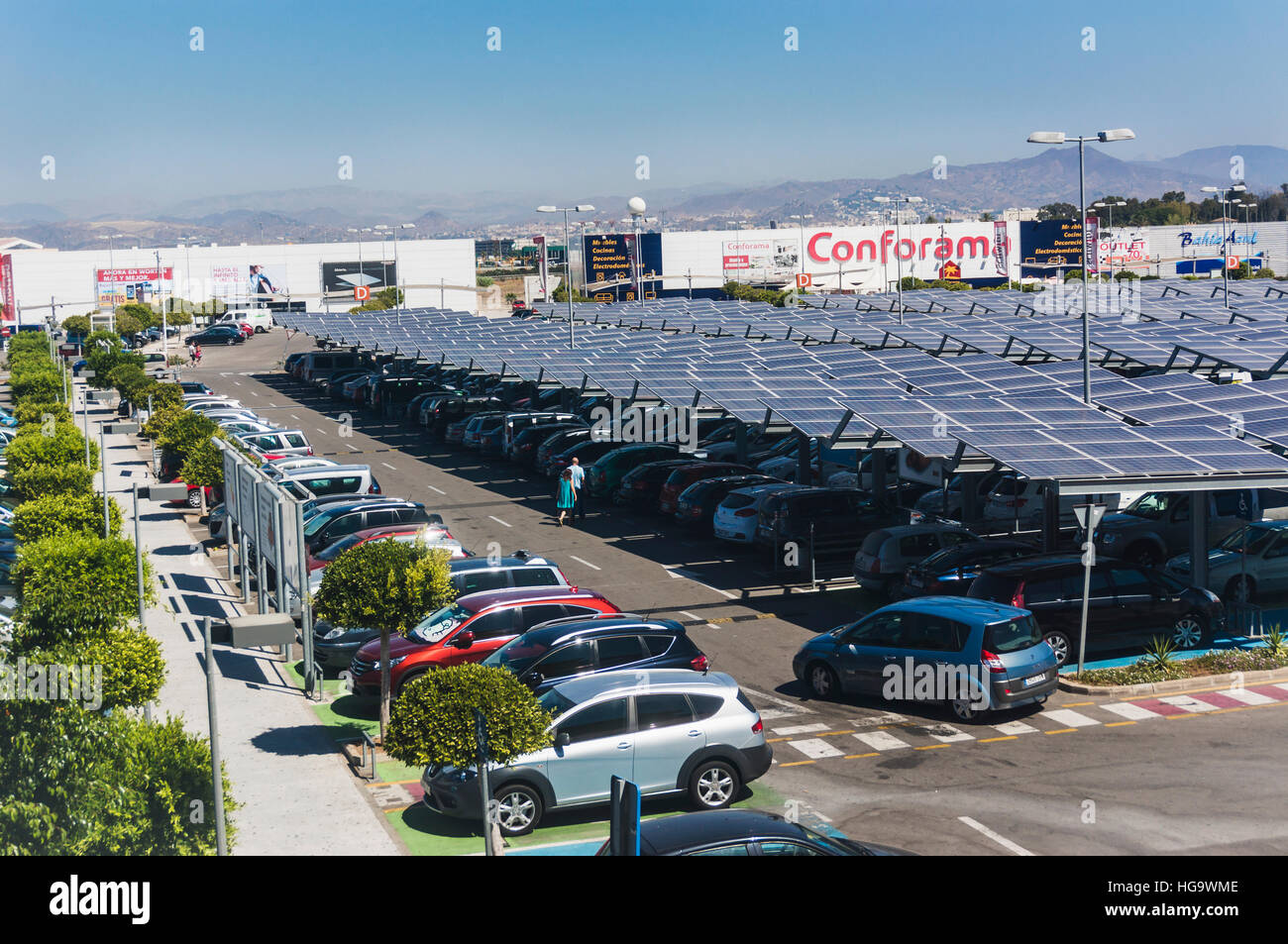 Used Ikea solar panels used as roofs to shade parking bays in ikea car park