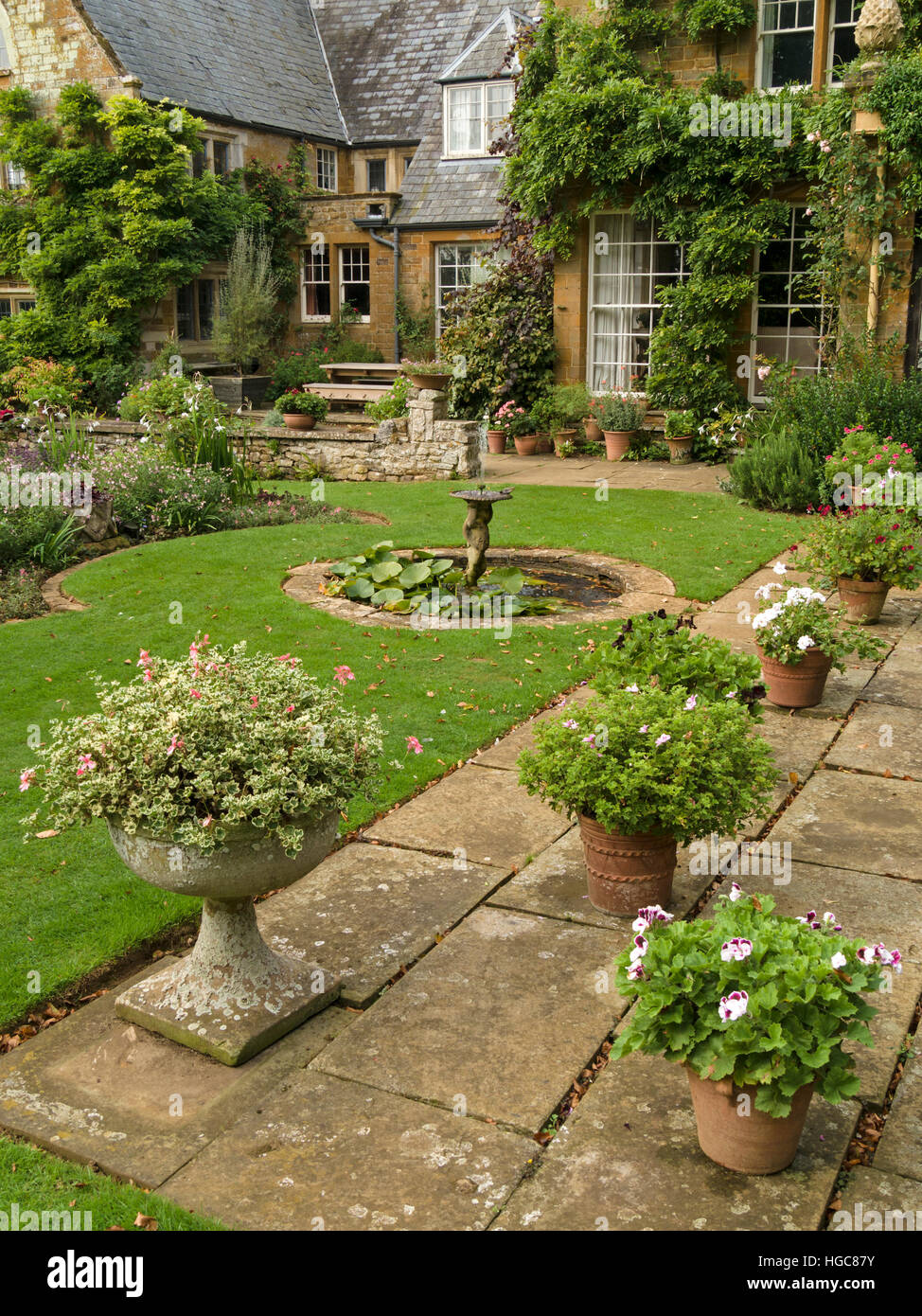 Patio Pots And Planters In Gardens Of Coton Manor House, Coton,  Northamptonshire, England, UK.