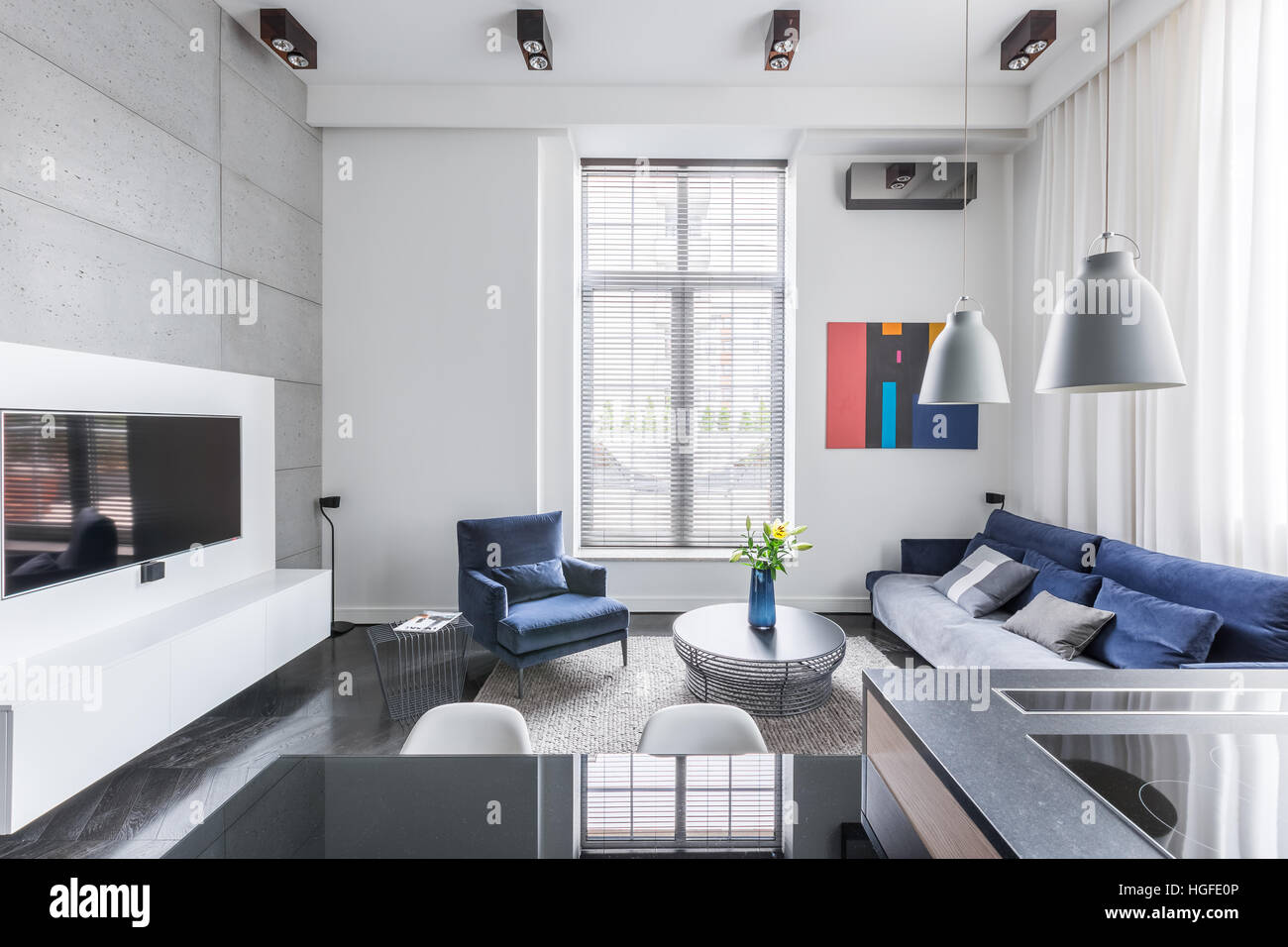 White tv living room with blue upholstered furniture Stock Photo ...