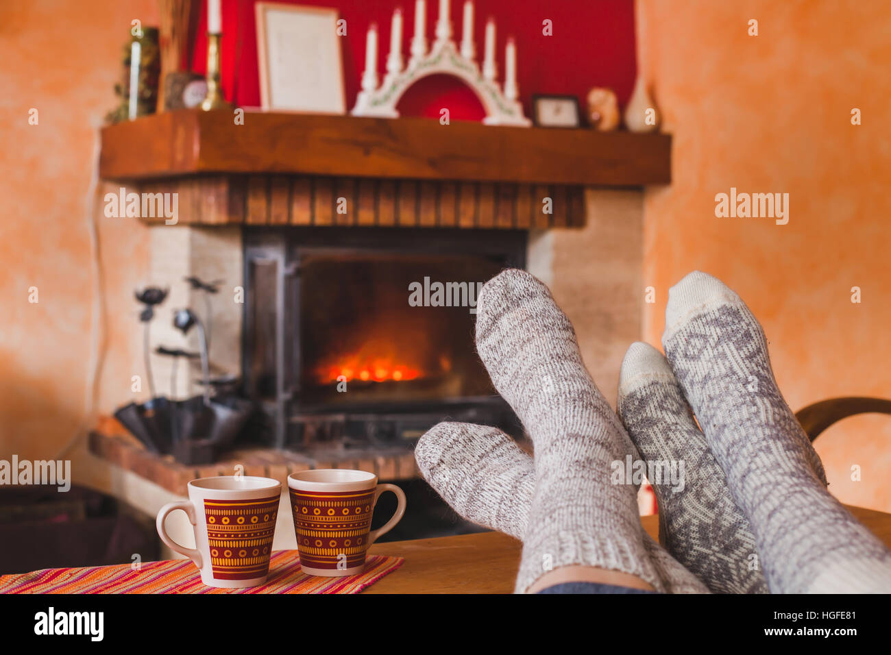 cozy family evening at home near fireplace in winter feet of