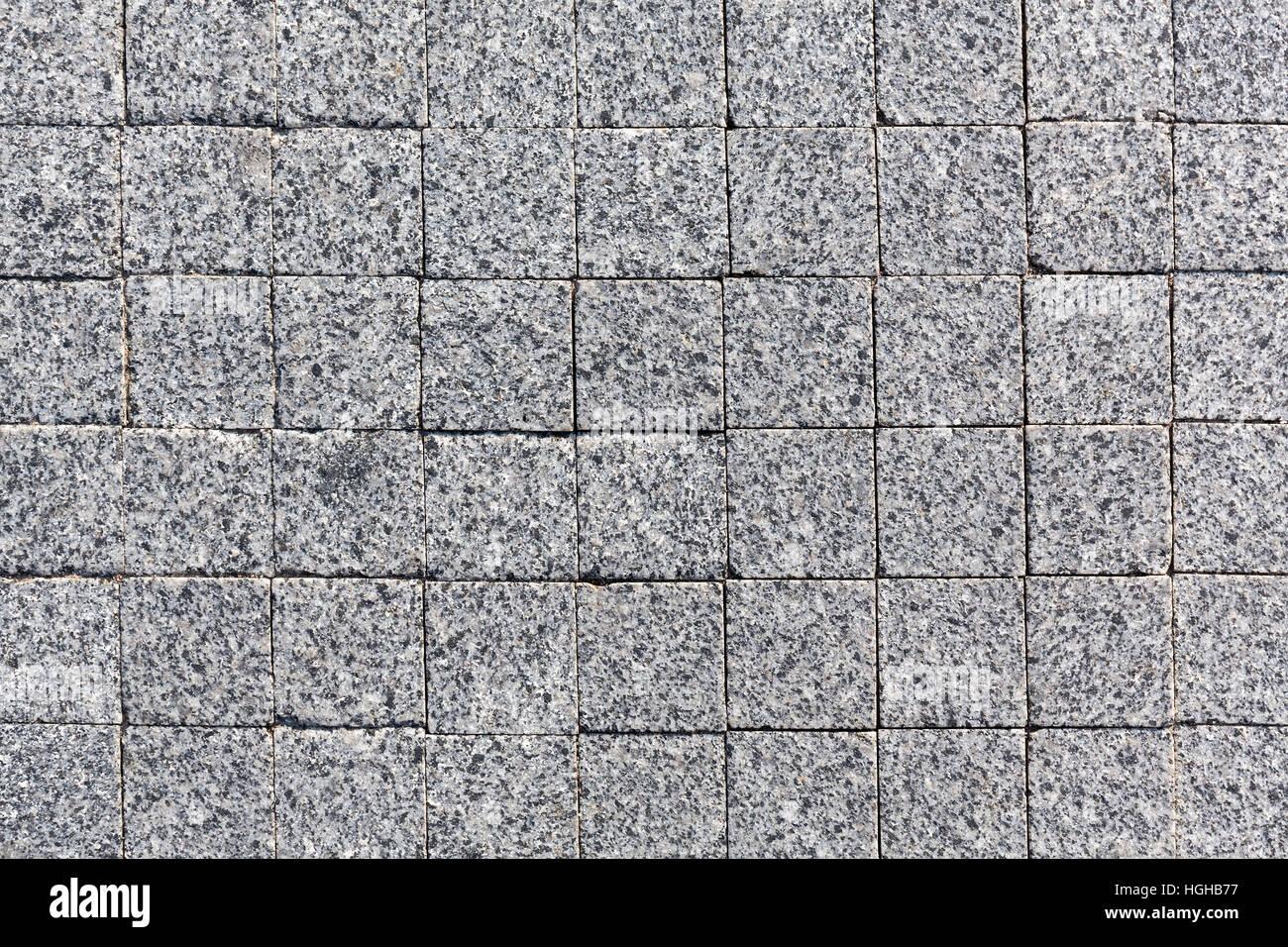 Dark granite paving st...