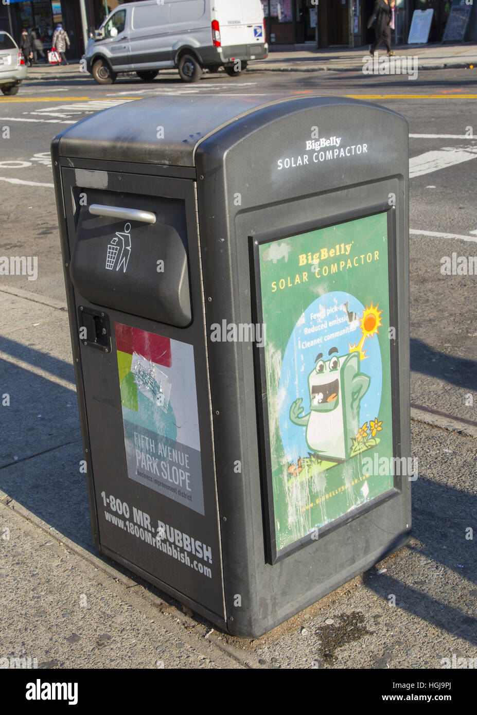 Trash can with solar powered compactor on the street in What is trash compactor and how does it work