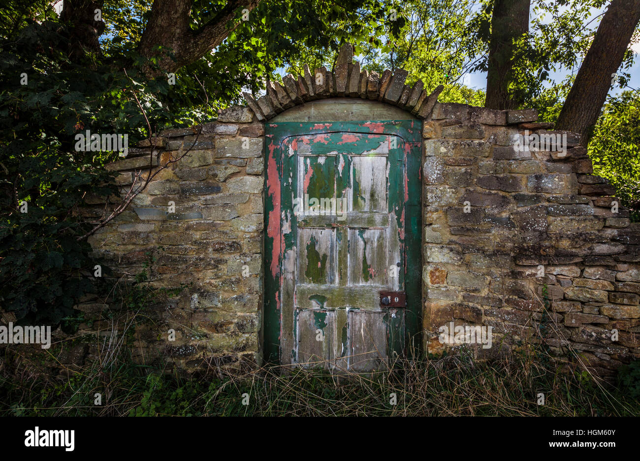 Old garden house - Old Garden Door In A Brick Wall With Flaking Paint