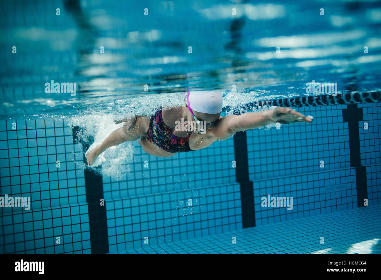 stock photo underwater shot of female swimmer in action inside swimming pool young woman training in the pool - Inside Swimming Pool