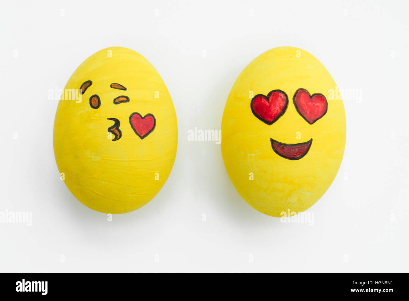 painted emoji easter eggs in different moods and