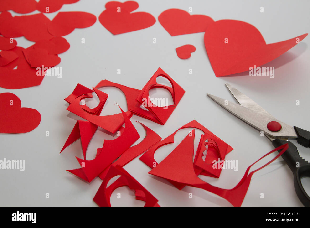 Preparation of greeting cards for valentines day from red paper preparation of greeting cards for valentines day from red paper hearts and scissors kristyandbryce Gallery