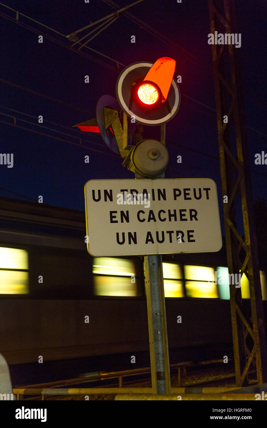Red traffic signal flashing light warning lights at a French