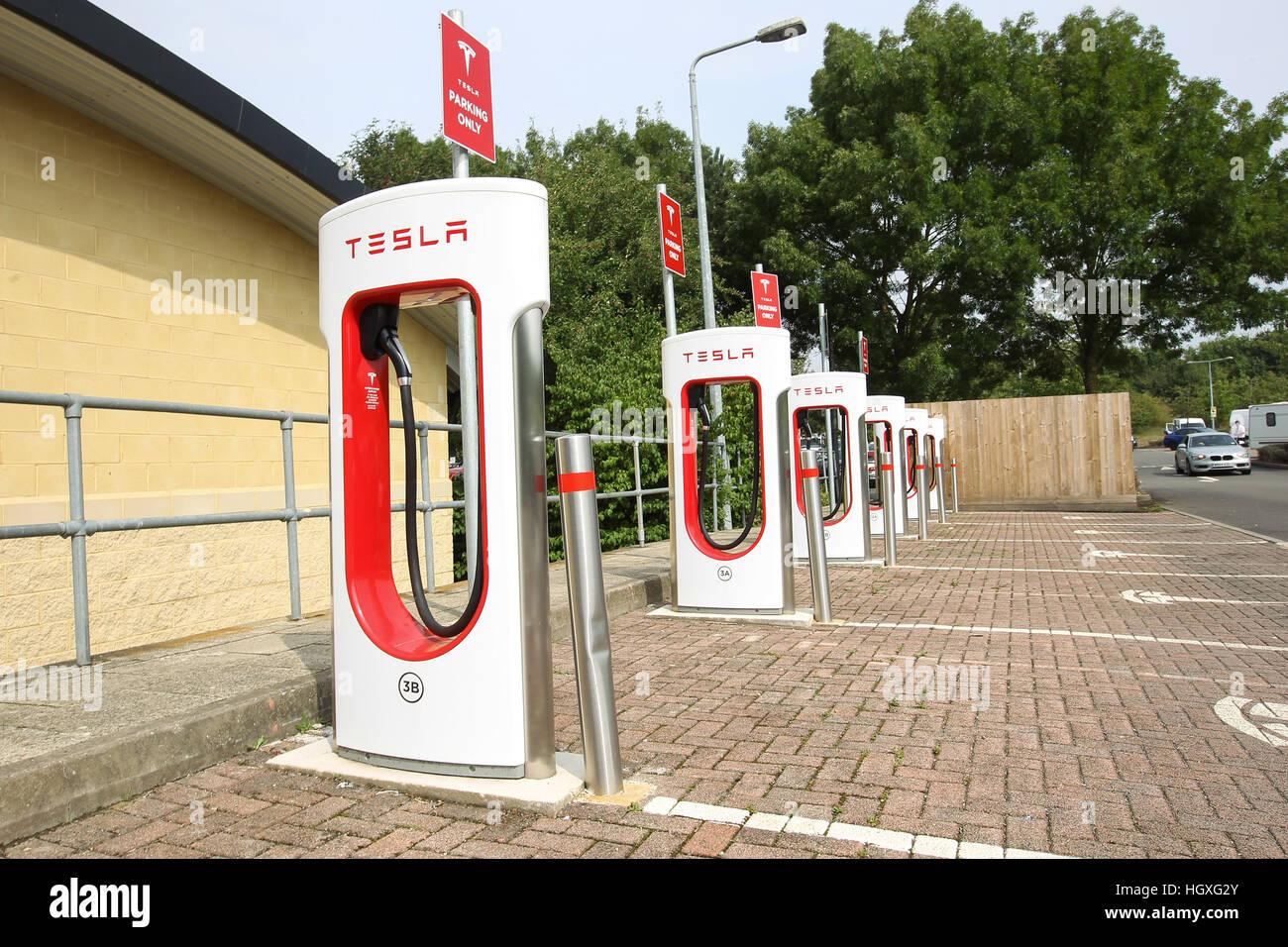 empty tesla electric car vehicle charging stations england uk stock photo royalty free image. Black Bedroom Furniture Sets. Home Design Ideas