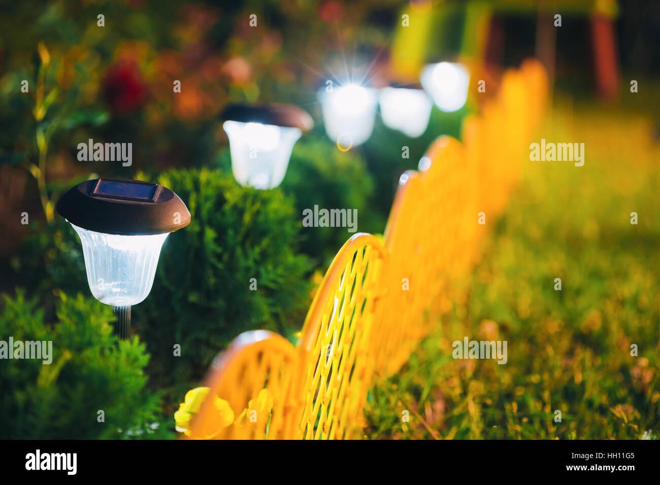 Decorative Small Solar Garden Light, Lanterns In Flower Bed In Green ...
