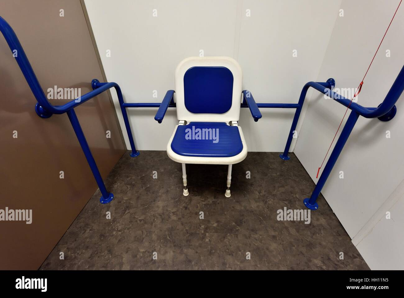 A disability chair in a changing room cubicle in a UK store Stock ...