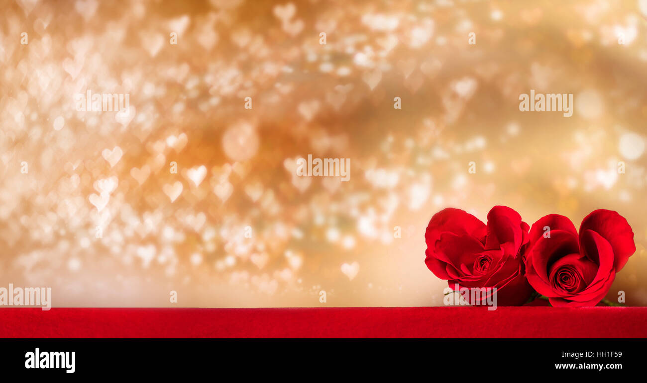 Two heart shaped red roses on golden glowing bokeh hearts ...
