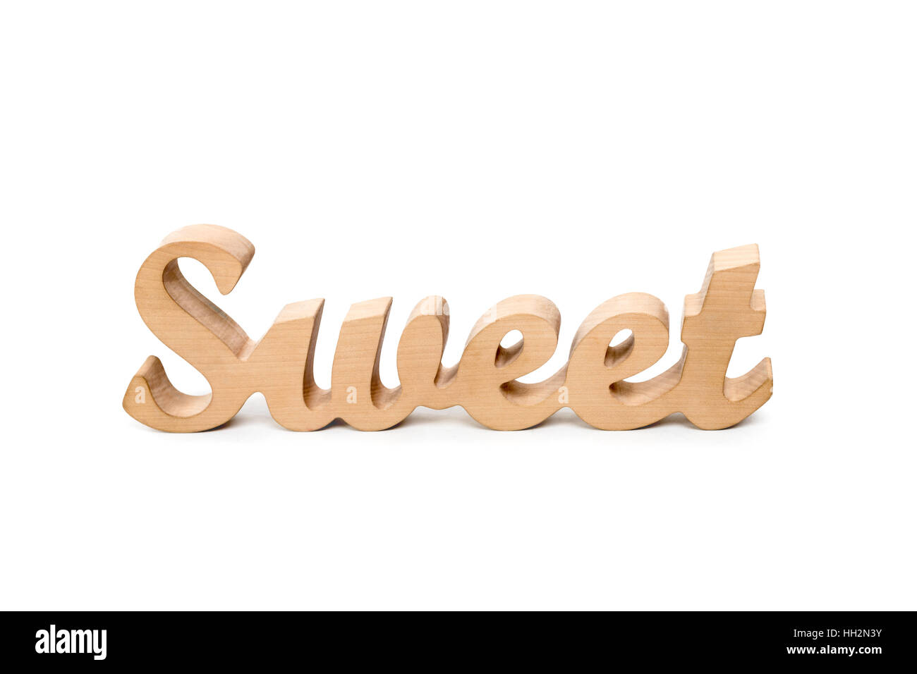 Word sweet, wooden letters on white background. Lovestory or wedding decor