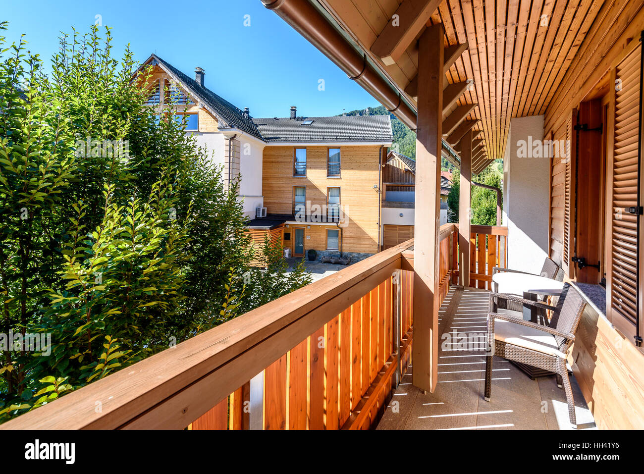 Modern wooden terrace balcony with table and chairs for Balcony terrace