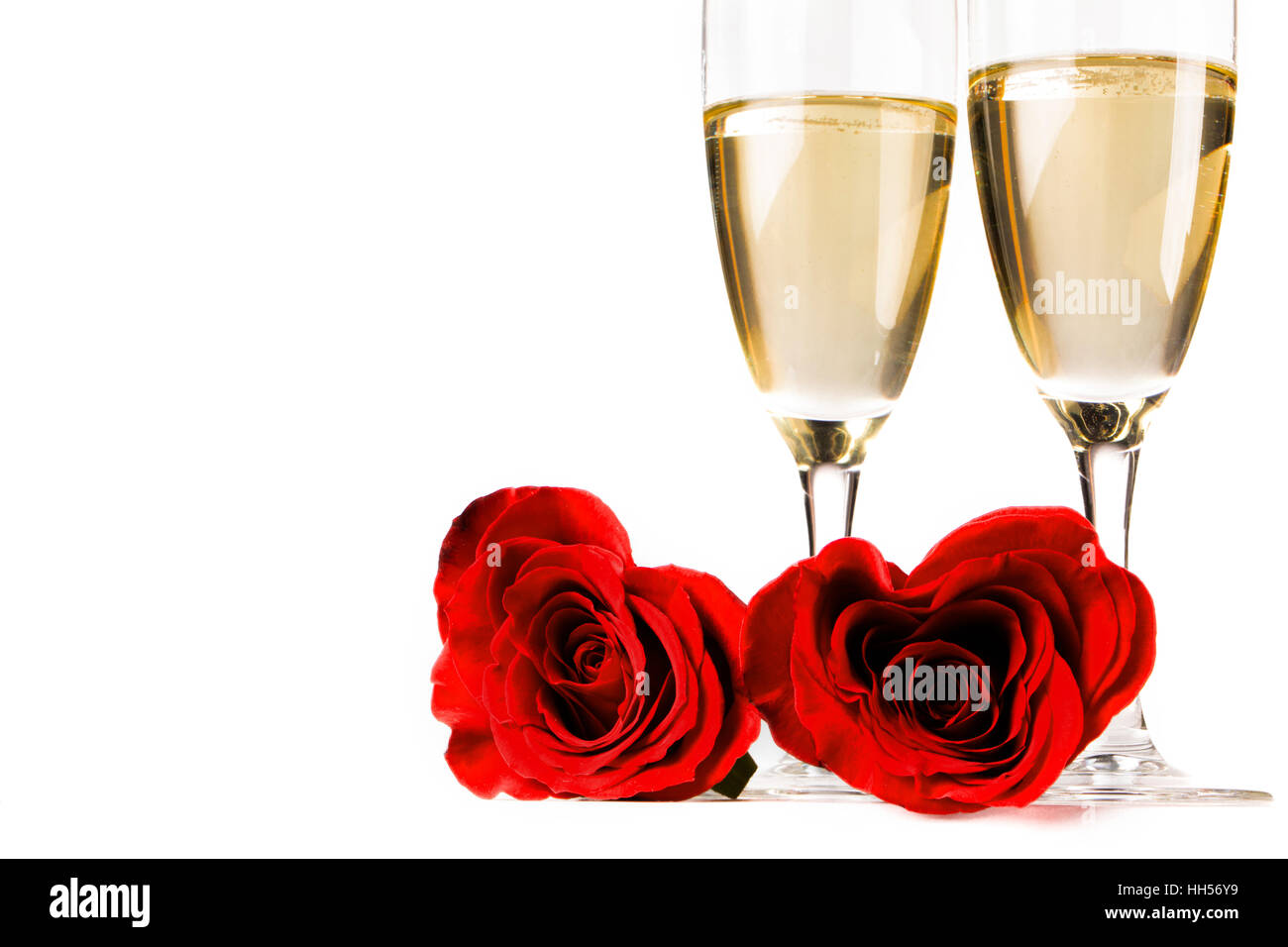 Two heart shaped red roses and champagne isolated on white Stock ...
