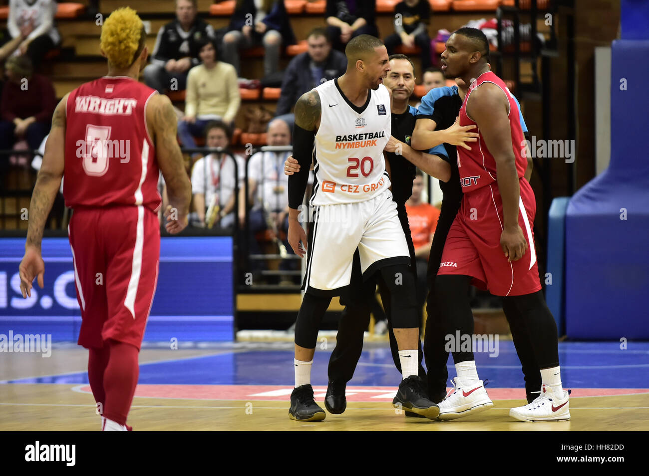 DIAMON SIMPSON (centre) of Nymburk and JORDAN ABOUDOU (right) of Monaco in  action during the Men's basketball Champions League 13th