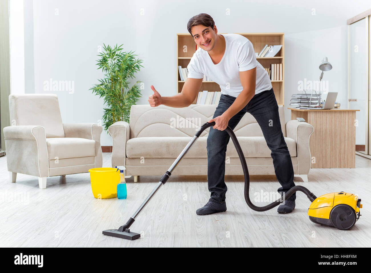Cleaning The House man husband cleaning the house helping wife stock photo, royalty