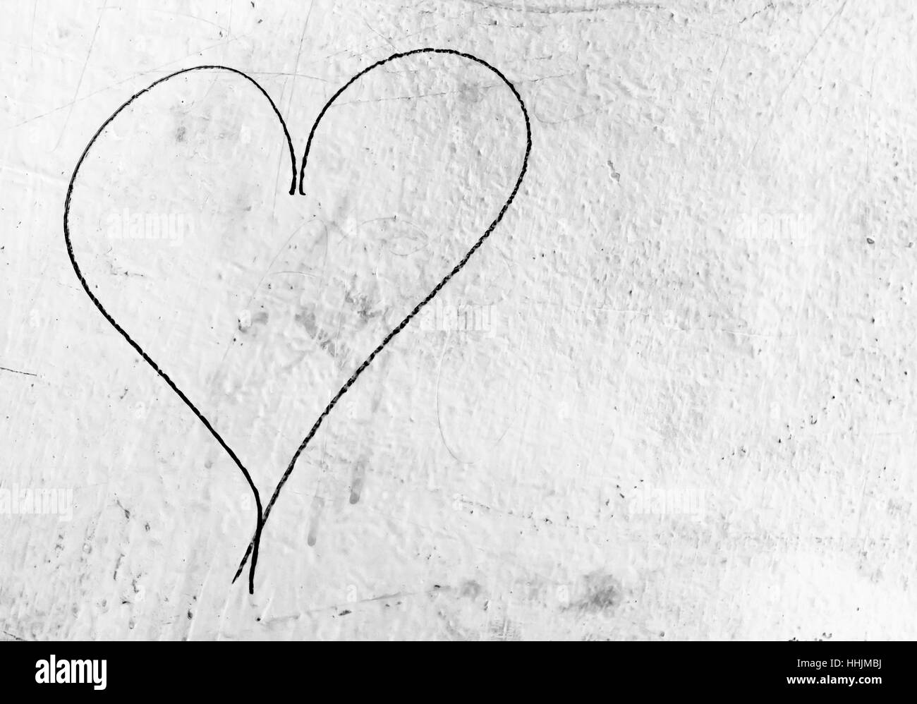 Concept or conceptual painted black abstract heart shape love concept or conceptual painted black abstract heart shape love symbol dirty wall background metaphor to urban and romantic valentine grungy style biocorpaavc Choice Image
