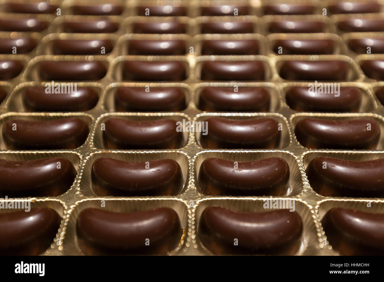 box of chocolates all in a row Stock Photo, Royalty Free Image ...
