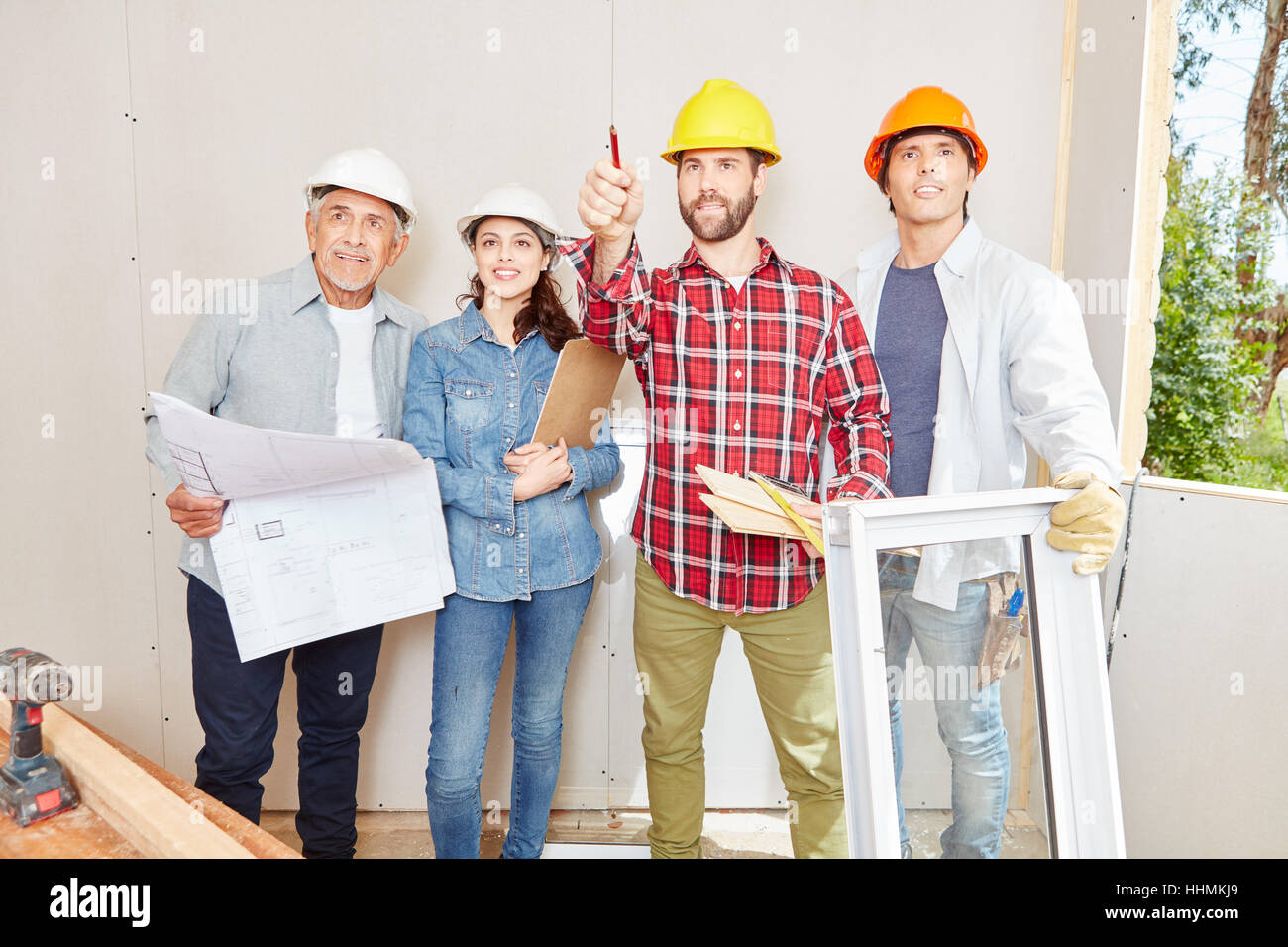 Stock Photo - Successful architects building woodhouse and planning