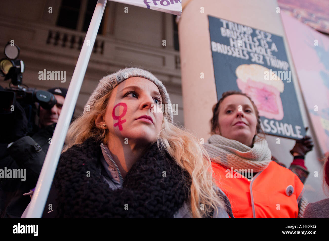 Brussels belgium 20th jan 2017 a protester with the gender a protester with the gender symbol for women on her cheek at the lights for rights womens march in brussels for equal rights and against trump buycottarizona Image collections