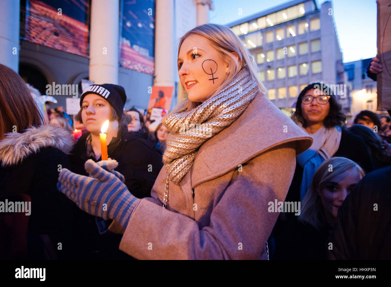 Brussels belgium 20th jan 2017 a female protester with the a female protester with the gender symbol for women on her cheek holds a candle at the lights for rights womens march in brussels for equal rights buycottarizona Image collections