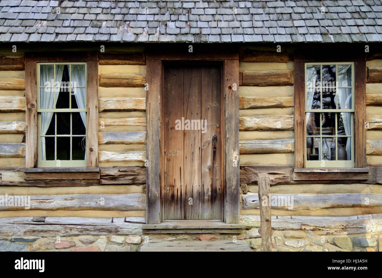Traditional Pioneer Log Cabin. Exterior front door and wall of ...
