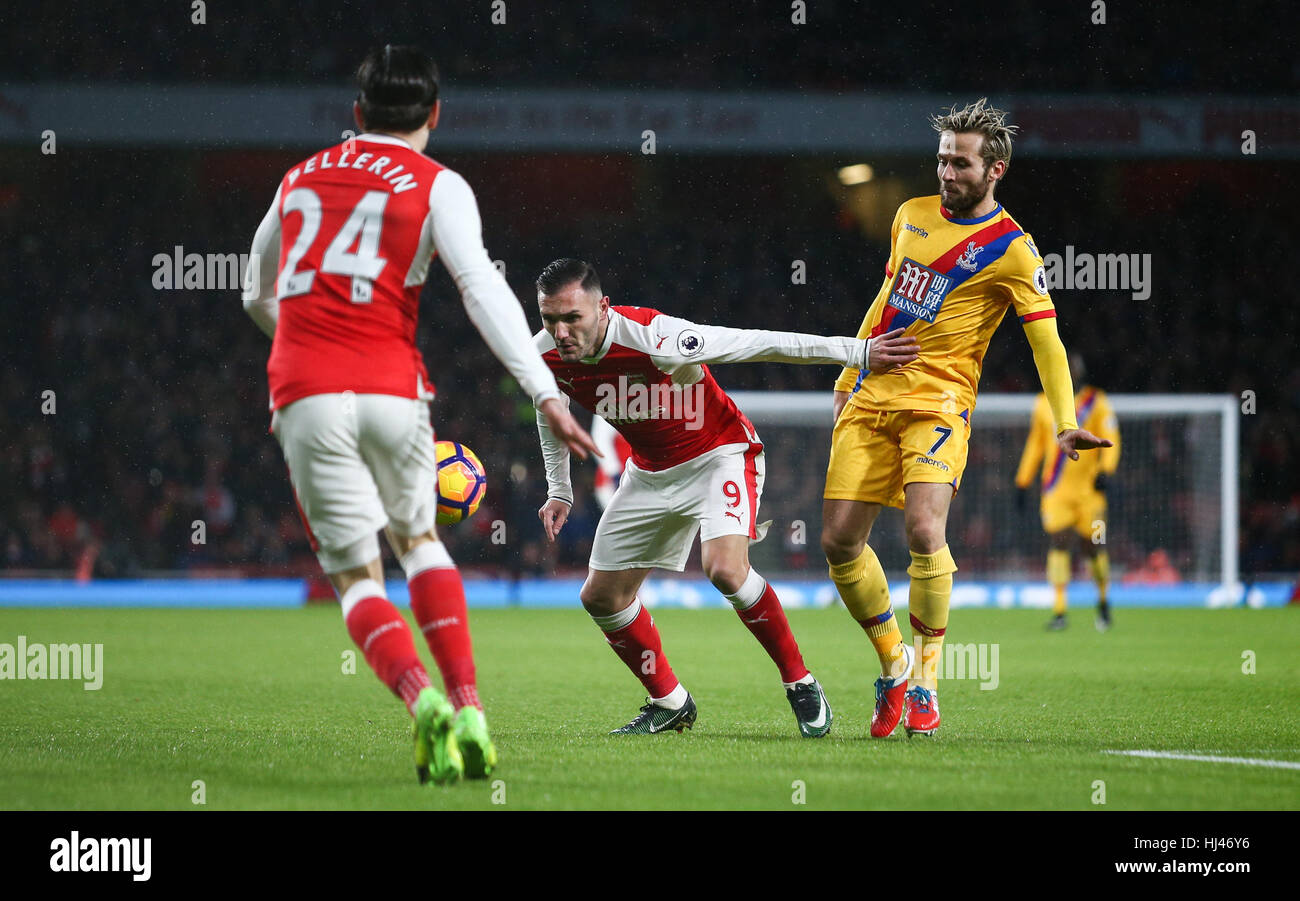 Lucas Perez of Arsenal 9 holds off a challebge from Yohan Cabaye