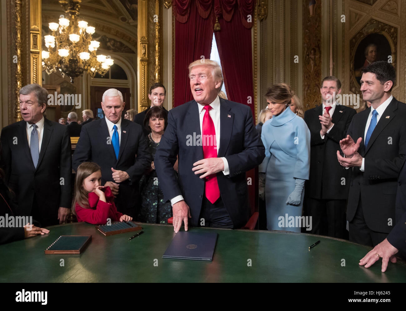 United States President Donald Trump is joined by the ...