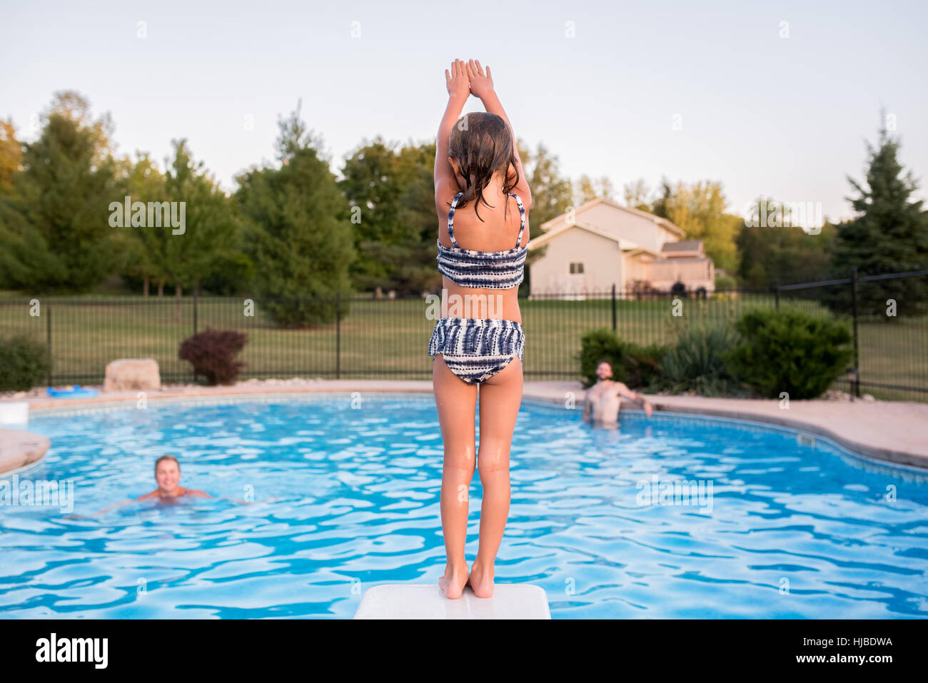 Young Girl Preparing To Dive Into Swimming Pool Father