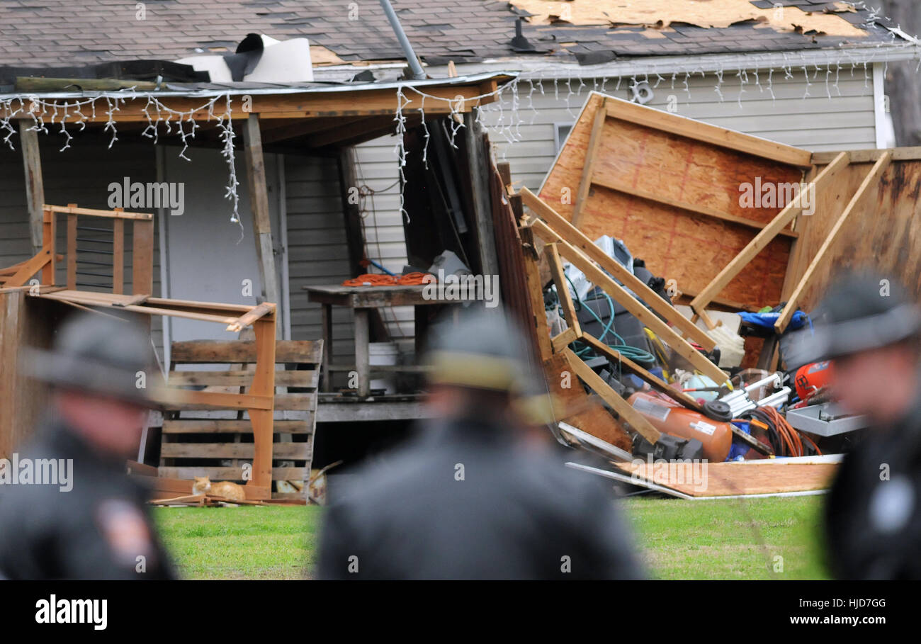 Police Stand Guard Near A Damaged Home At The Sunshine Acres Mobile Park In Adel Georgia Where Violent Tornado Leveled Half Of 40 Homes