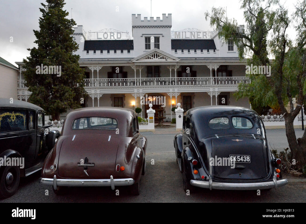 Old classic cars in front of historic Lord Milner hotel Stock Photo ...